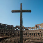Finding Glory in Pain and Problems Part 1 of 2 - Weekly Blog Post by Dr. Craig Biehl - cross in Roman coliseum