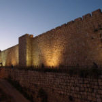 Barbarians at the Gate: Where do We Turn? Weekly Blog Post by Dr. Craig Biehl - stone wall of Jerusalem lite up