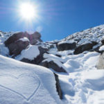 To Know Him Is to Love Him - Weekly Blog Post by Dr. Craig Biehl - snowy mountainside in bring sun, heart drawn on snow bank