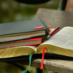 We Depend on God's Word and Words - Weekly Blog Post by Dr. Craig Biehl - open Bible, journal, notebooks on table