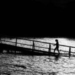 Presuppositions of Faith (1 of 6): Faith as the Basis of Reason - women on bridge in lake black and white
