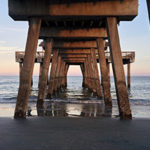 Presuppositions of Faith (5 of 6): The Problem of Evil - underneath pier pylons looking out to open ocean