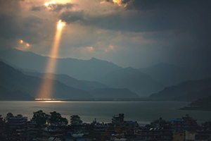 Sought, Saved, and Exalted by God's Infinite Grace - Japanese homes on bay sunlight shining through clouds