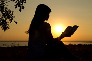 Wisdom Concerning the Secret and Revealed Things - women reading Bible in sunset