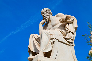 Is Philosophy Bad? - marble statue of man thinking against blue sky
