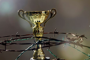 The Father's Conditional Love of Christ - Weekly Blog Post by Dr. Craig Biehl - barbed wire surrounding gold cup