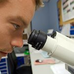 The Limits of Scientists and the Scientific Method - Weekly Blog Post by Dr. Craig Biehl - man looking into microscope