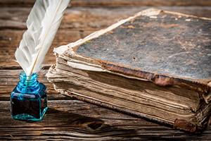 Gleanings from The Religious Affections Part 2): Why Edwards Wrote It - Weekly Blog Post by Dr. Craig Biehl - old book with ink well and quill