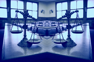 """The Human Limitations of Unreasonable Atheism (Part 20): """"Doctrinal Disproofs"""" (Part D) - Weekly Blog Post by Dr. Craig Biehl - two scales of justice in empty courtroom"""