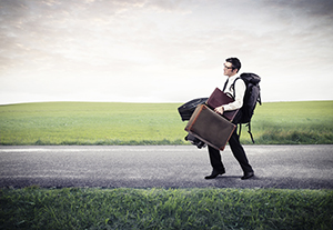 Baggage, Responsibility, and the Display of God's Excellence - Weekly Blog Post by Dr. Craig Biehl - man weighted down by baggage